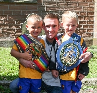 Brothers Joseph and Anthony with boxing champion K