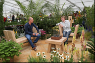 Having a quiet chat are top garden designer Joe Sw