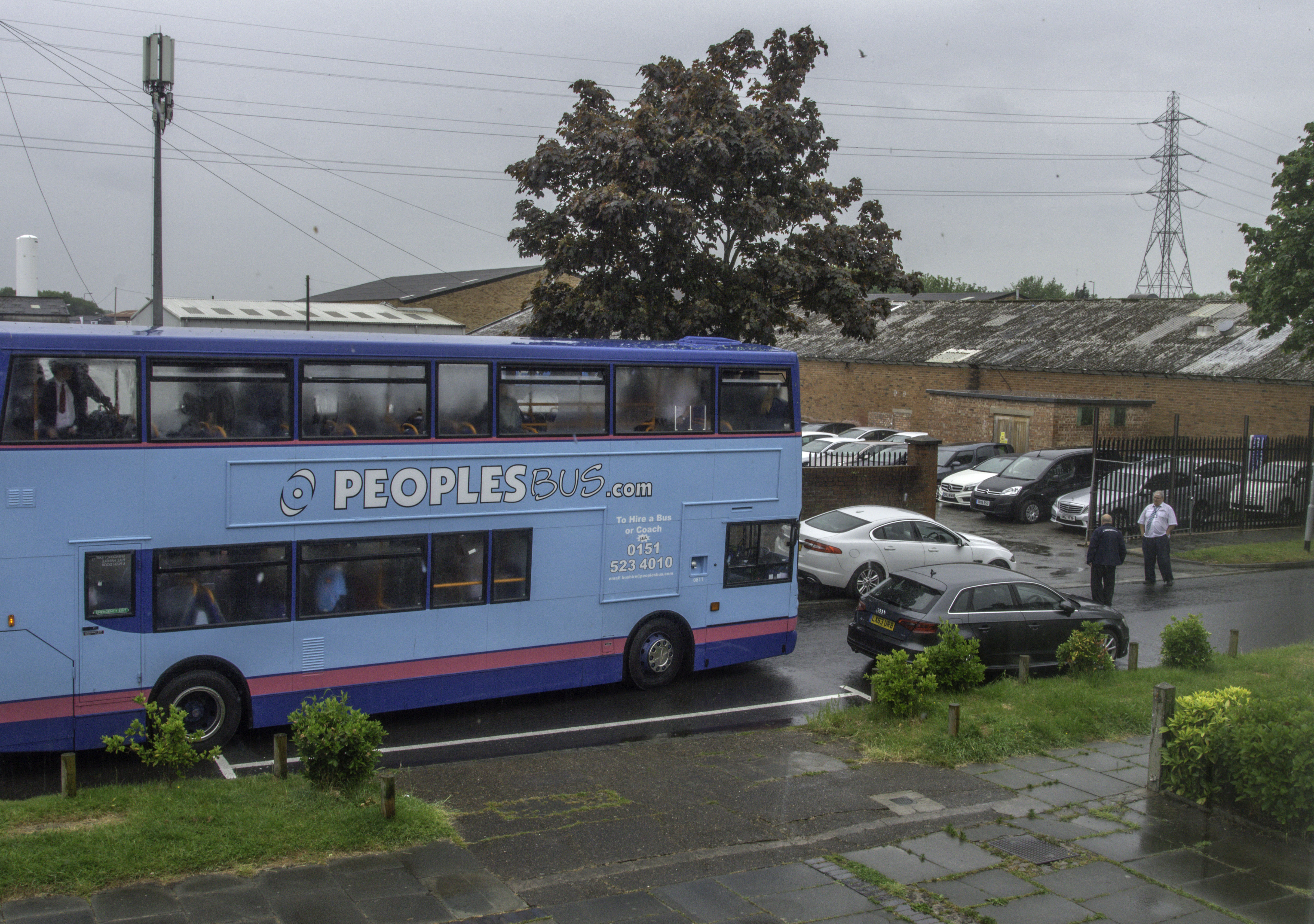 Action urged to stop parked cars blocking school buses on road