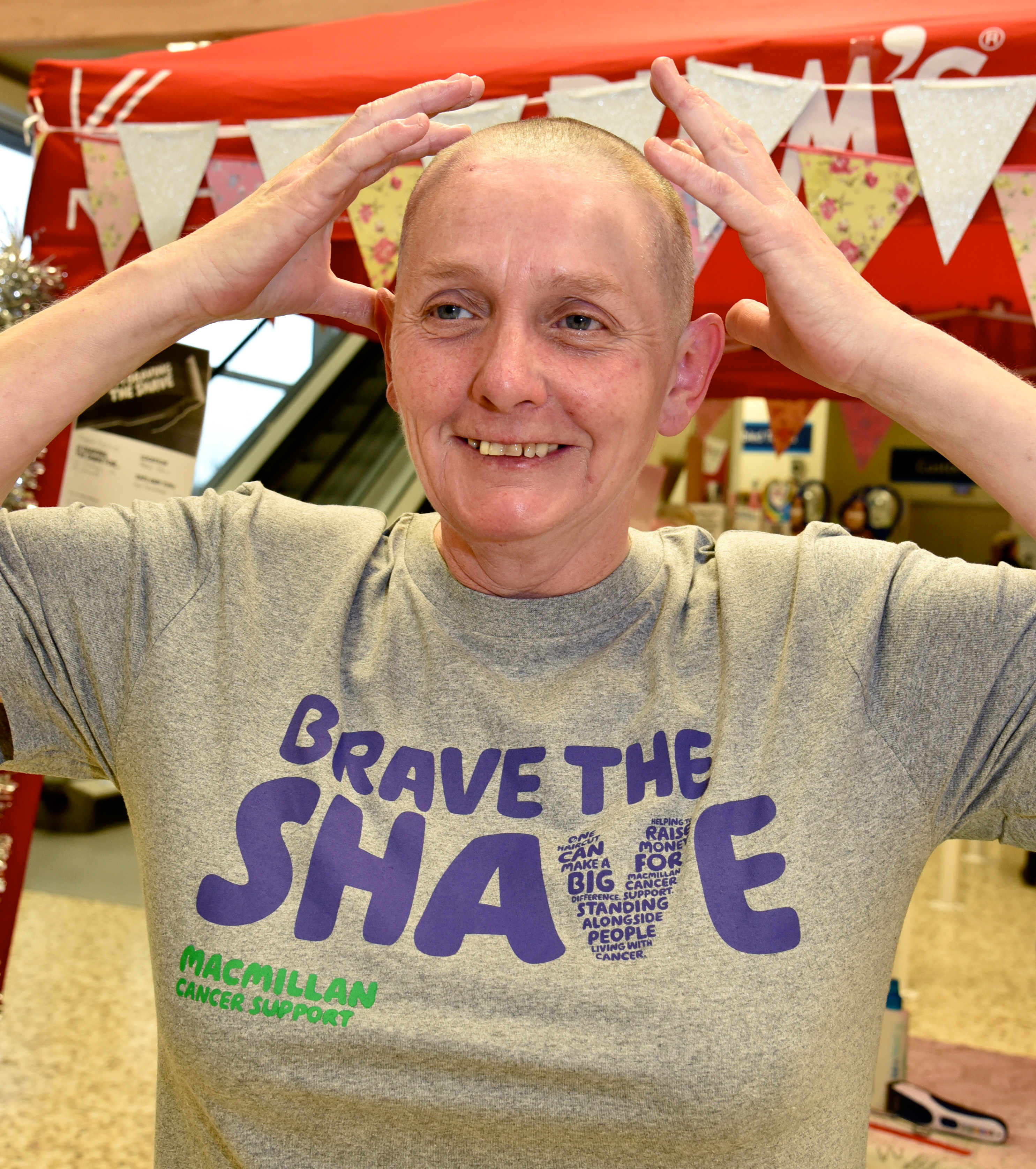Tesco worker braves the shave for charity while store staff launch pyjamas appeal