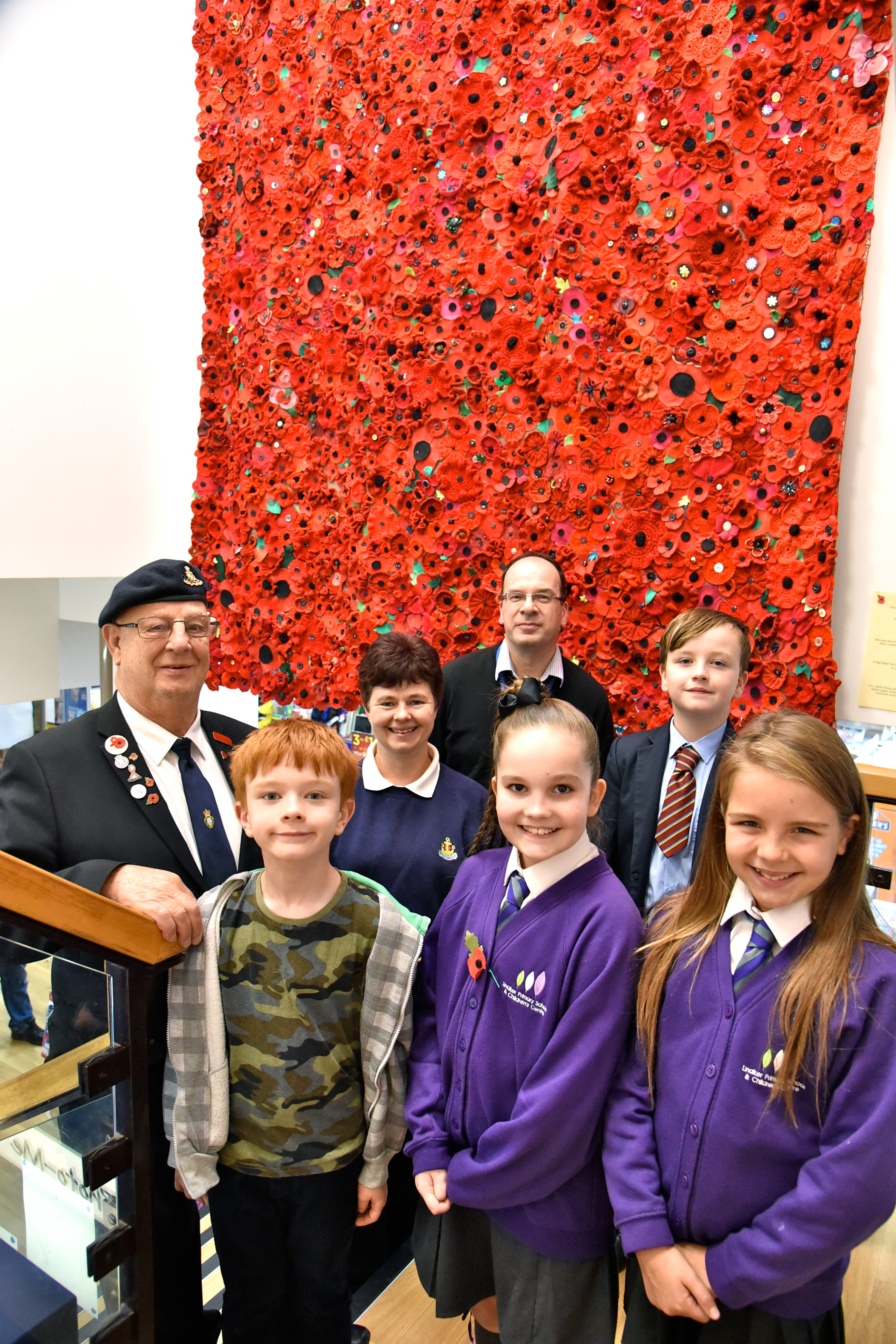 Thousands of hand-knitted poppies donated to store
