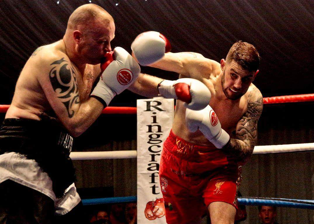 Bootle boxer claims narrow win