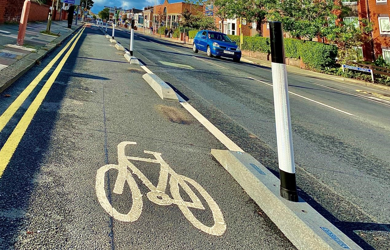 Temporary bollards which cost more then £84,000 could be removed in six months time, warns councillor