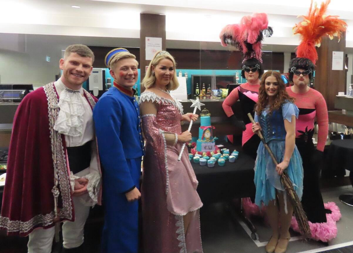 Cinderella cast told to 'bake a leg!' after local cake maker presents them with special gift!