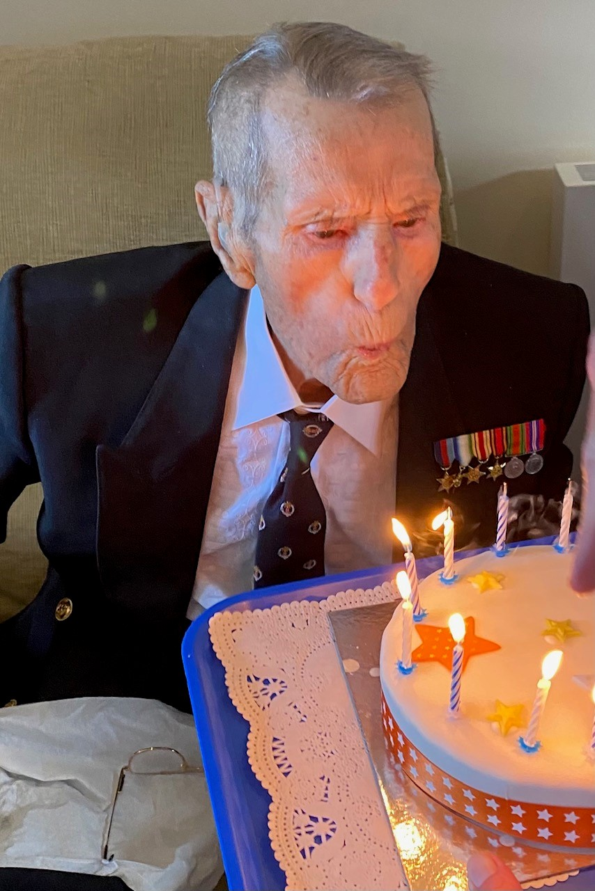 World War Two sergeant blows out the candles to celebrate his 100th birthday!