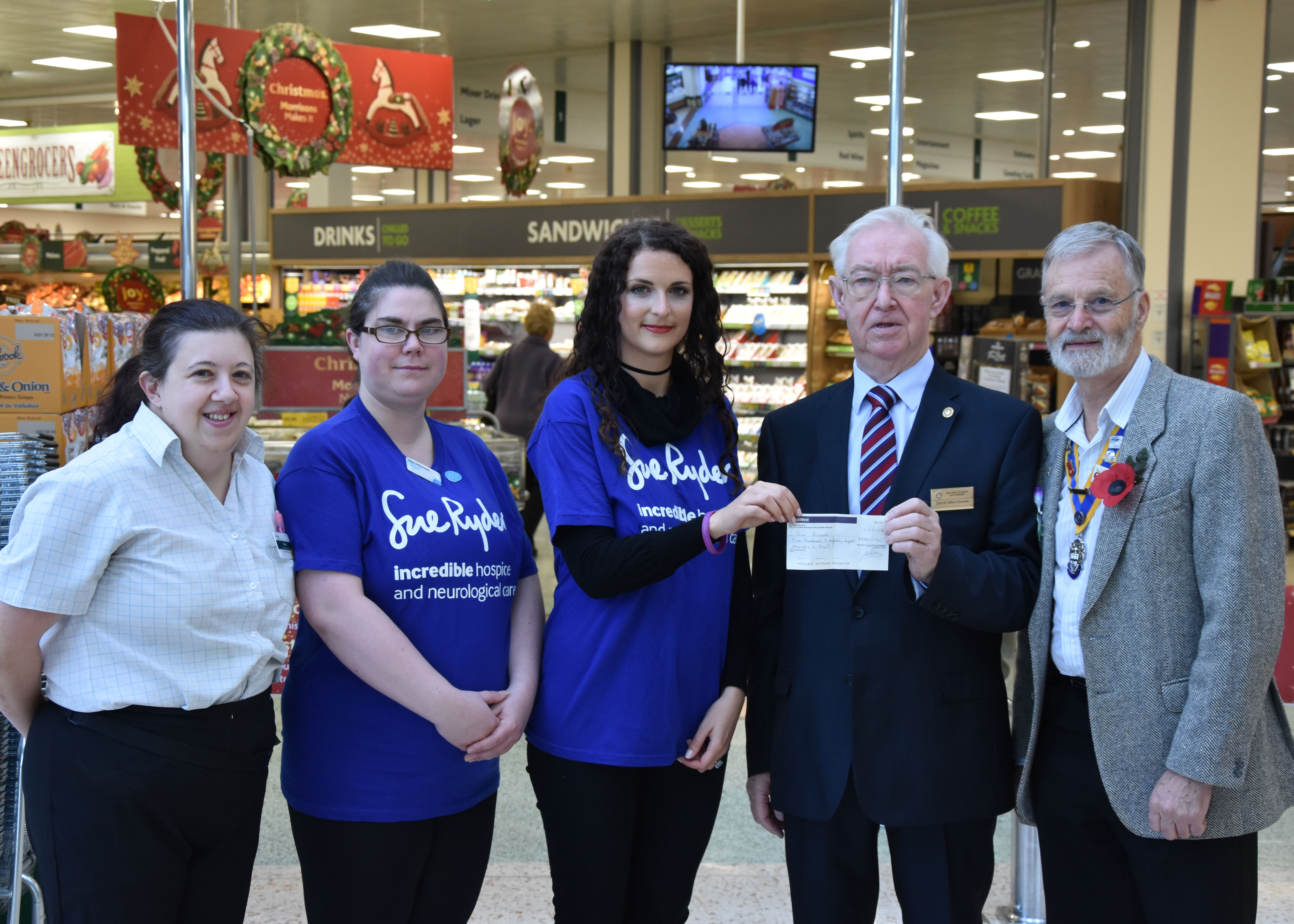 Rotarians team up with store staff to help Sue Ryder charity