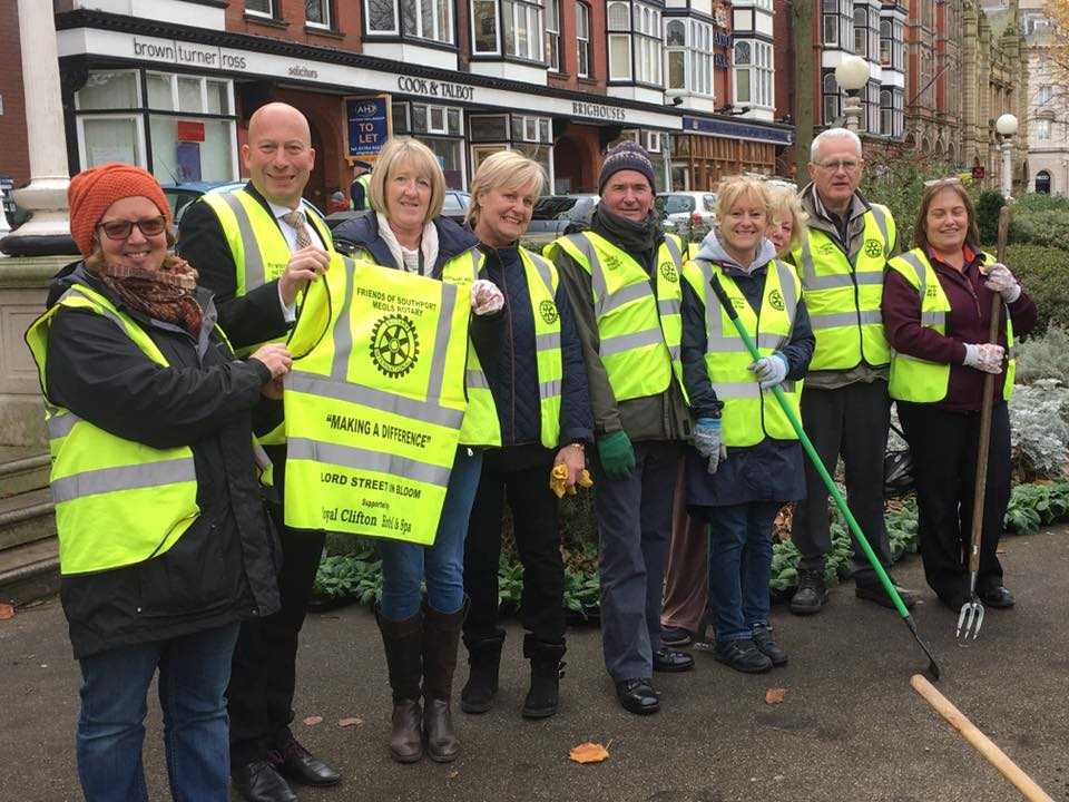 Rotary members dig in to help town's bloom group keep up their good work
