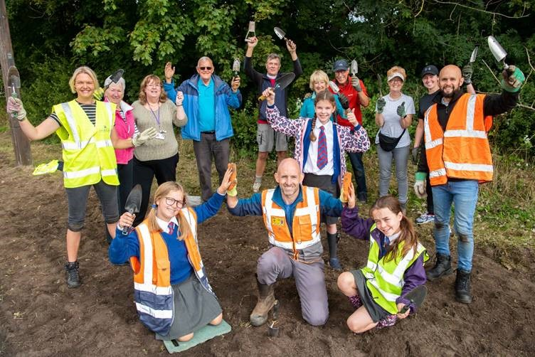 One thousand daffodil bulbs are planted at the Marie Curie Field of Hope
