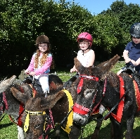 Enjoying the Donkey Rides are six year old Aimee,