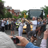 The Olympic flame relayed at Southport's Cumberlan